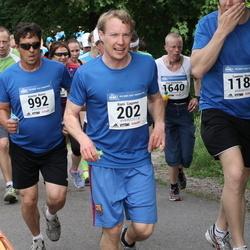 Helsinki Half Marathon - Rami Gagneur (202), Kimmo Nuora (992)