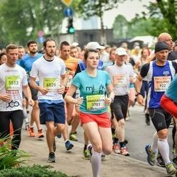 The 26th Lattelecom Riga Marathon - Anastasiya Akhremka (3701), Endijs Bošs (5513)