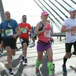 The 27th Lattelecom Riga Marathon - Alexander Volkov (1604), Olga Panfilova (1605), Guntis Erbs (6087)