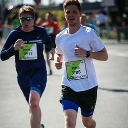The 27th Lattelecom Riga Marathon - Toms Biders (3708), Pavel Mishinev (3911)