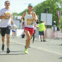 Tet Riga Marathon - Nikolajs Mitičkins (23418), Evija Mitičkina (28008)